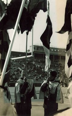 Students holding flags at 1976 University of Minnesota Homecoming.