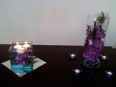 The one on the left is WINNING! I smell DIY :) my changes: round mirror and purple, silver and teal glass beads on bottom with a purple ribbon (maybe a thin teal and/or white ribbon too) Peacock Wedding Centerpieces, Simple Centerpieces, Diy Wedding, Wedding Flowers, Dream Wedding, Wedding Ideas, Purple Wedding, Wedding Themes, Wedding Stuff