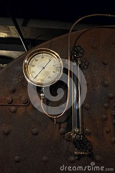 This is a vintage brass gauge one the boiler unit of a very old steam boat called the Ticonderoga. Next to the gauge is a glass cylinder with relief valves. Steam Boats, Relief Valve, Boiler, Gauges, Ships, The Unit, Brass, Stock Photos, Vintage
