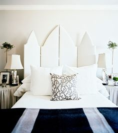 This screen-as-headboard reminds us of our Ornate Bed.  The white upholstery is a chic choice for this architectural piece.