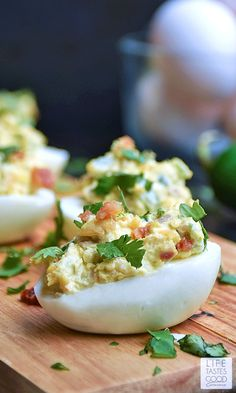 Jalapeno Popper Deviled Eggs | by Life Tastes Good. Can you imagine the goodness?! A deliciously tasty twist on Jalapeno Poppers loaded with cream cheese, fresh jalapeno, cheddar cheese, and BACON all stuffed into an edible dish you can eat with your hands! This might just be the perfect appetizer...