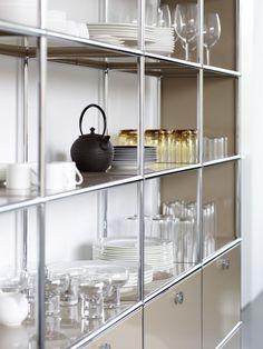 USM Haller shelving in USM beige. Modern shelf in the kitchen and living room.