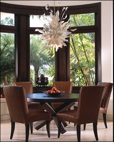 Private Golf Club Jupiter, Florida  The breakfast room in this 11,000 square foot home was featured on the cover of a national magazine after winning several awards. The use of dark woods and a shattered porcelain chandelier inspire the core of this dynamic home.