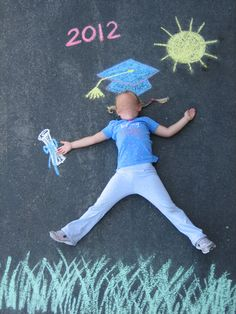 Kindergarten promotion picture. Chalk drawn on the playground. Photo taken on a ladder. Thanks Marcie!