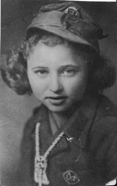 Elena Lagadinova - The youngest female partisan fighting against the fascists in Bulgaria in WWII    This picture is from October 1944.  Elena Lagadinova was only 14-years-old.  The chain around her neck was connected to her pistol so she would not lose it.  She joined her father and three brothers fighting against the German-allied Bulgarian government when she was 11, running messages to the partisans while also trying to finish school.