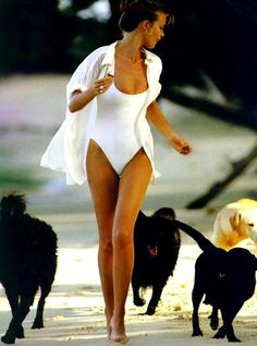 What a great photo, I don't know which I like better the white bathing suit or the lovely dogs. Let me think... the dogs. They will always win with me!