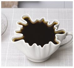 This would be really interesting to drink from. Either really easy, or impossible. Ceramic. splat form.