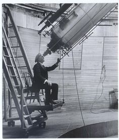 Percival Lowell, founder of Lowell Observatory, looking through the Clark telescope.