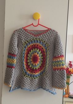 Flower center crochet top.