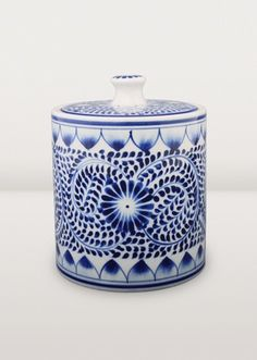 Spiraling vines and flowers in Vietnamese blue and white circle this tasteful small canister, an attractive addition to your kitchen. Beautiful!