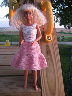 Lots of Free doll clothes patterns here - http://barbiebasics.tripod.com/knits.html     Ravelry: Country Girl Dress pattern by Lynne Sears