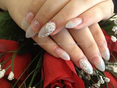 Sharp almond shape acrylic nails with glitter, 3D roses and Swarovski crystals