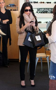 "Reality star Kim Kardashian rockin the American Express ""Black Card"" while shopping at ""Optometrix"" in Beverly Hills, CA on January 7, 2012. She was swamped by fans as she left the store"