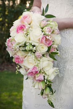 Pretty Cascade/Teardrop Bridal Bouquet Arranged With: White Lily Of The Valley, White Roses, Pink Tulips, Green Foliage Cascading Wedding Bouquets, Cascade Bouquet, Wedding Flower Arrangements, Bride Bouquets, Bridal Flowers, Wedding Centerpieces, Floral Wedding, Wedding Decorations, Horse Flowers