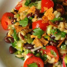 Black Bean and Barley Salad Recipe – The Lemon Bowl.forget the chips sounds like a yummy side to some grilled chicken. Sub Lime for Lemon Barley Salad, Soup And Salad, Vegetarian Recipes, Cooking Recipes, Healthy Recipes, Healthy Foods, Beans And Barley, Clean Eating, Healthy Eating