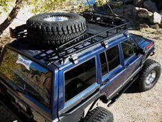 Roof Rack W Swing Down Tire Carrier 1996 Xj Expedition Rig Jeep Xj Jeep Zj Jeep Xj Mods