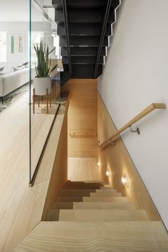 Access to the basement is via a wood-lined stairway.