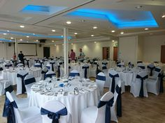 Navy blue satin sashes on white covers at Mshed Bristol