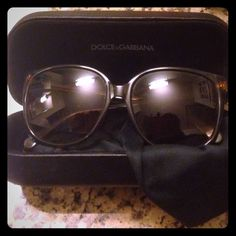 Dolce and gabbana large sunglasses Large brown and black dolce and gabbana sunglasses they are larger frames and they have a little bit of a cat eye look to them. They have a few tiny scratches on the left lens but are hardly noticeable other than that there is no  damage. The sunglasses come with the large black dolce and gabbana sunglasses case, and a duster/ bag for the sunglasses that has dolce and gabbana engraved on it. These are 100% authentic and gorgeous they match with everything…