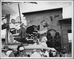 Director Cecil B. DeMille on location at the Gates of Per-Rameses in Egypt, during production of THE TEN COMMANDMENTS, 1956. Others unidentified.
