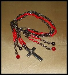 El Secreto Encanto De La Diva: -    Red and black bracelet with beads and a cross. It´s amazing!