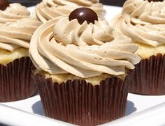 The BEST vanilla cupcakes with the BEST coffee buttercream frosting.  A double sweet treat, for sure!   www.thekitchenismyplayground.com