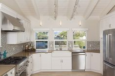 backsplash with grey and taupe..Dana Point Remodel by Sea Pointe Construction
