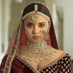 The quintessential Sabyasachi Bridal Jewelry crafted in gold with uncut diamonds and South Sea Pearl detailing. Paired with a beautiful… Indian Bridal Lehenga, Indian Bridal Fashion, Indian Bridal Makeup, Indian Wedding Jewelry, Pakistani Bridal, Sabyasachi Lehenga Bridal, Indian Jewelry, Bengali Wedding, Indian Weddings