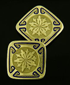 A striking pair of gold and blue enamel cufflinks created by Charles Keller & Co.  This dramatic pair of cufflinks features rich five-petal flower/snowflake motifs surrounded by bold blue enamel and stippled yellow gold borders.  Crafted in 10kt gold,  circa 1920.