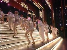 42nd street. White & gold, peggy in royal blue sequined gown, beautiful. Not the 42nd street ballet