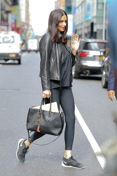 f5f43adf006d Adriana Lima sports rocker chic leather jacket at SiriusXM