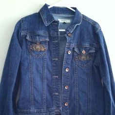Denim Jacket Gently worn.  Embroidery on pockets. Fits like large. Jeans