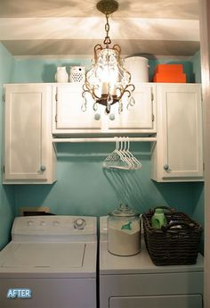 Chandelier in laundry room!!!!  Soo want to do this and take down ugly fluorescent factory looking light