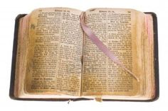 Old gothic antique vintage open bible with bookmark isolated on white background with cliping path  Stock Photo