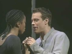 """Catch a glimpse into the powerful music and romance of """"Written in the Stars"""" from Elton John and Tim Rice's AIDA, produced by Disney. This clip stars performers from the original Broadway cast: Heather Headley (Aida) and Adam Pascal (Radames)."""
