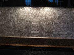DIY:  Faux Punched Tin Backsplash - using embossed wallpaper & metallic glaze.