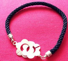 Hey, I found this really awesome Etsy listing at https://www.etsy.com/listing/182430464/fabulous-black-cord-silver-plated-flower