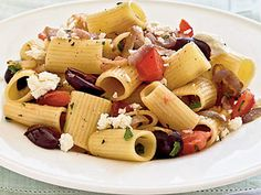Pasta with Caramelized Onions, Tomatoes, Parsley, and Olives | Learn how to make Pasta with Caramelized Onions, Tomatoes, Parsley, and Olives. MyRecipes has 70,000  tested recipes and videos to help you be a better cook