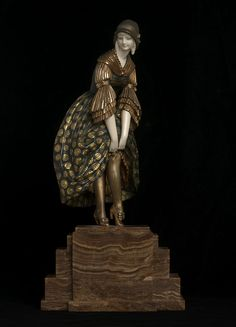 * Demetre H. Chiparus (Romanian 1886 - 1947), Paris, Sculpture; Cold-Painted, Parcel-Gilt and Silvered Bronze, Carved and Tinted Ivory, Marble and Onyx Base.
