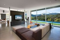 A living room with this view.. You can save some money if you have a look out of the window instead of looking TV! Really nice and inspiring picture!