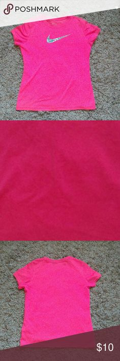 Nike, pink, dry-fit, t-shirt! It's a girl's Nike athletic shirt. It's a bright pink with a multi color logo on the front. It has a little stain in the front that your can barely see but other than that it's in good condition! Nike Shirts & Tops Tees - Short Sleeve