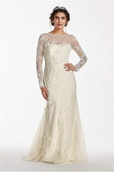 b0b288721c A dream wedding gown for that special fairytale day! This long sleeve lace  sheath gown features ribbon and lace applique detail with an illusion  boatneck ...