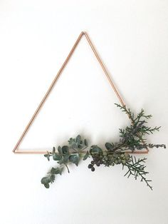 This Wall Hanging/Wreath is a perfect holiday statement piece. The copper triangle is modern and chic, while the greenery adds a natural touch and smells amazing! Perfect as a housewarming gift, hostess gift, or just a special treat for yourself, this wreath/wall hanging is sure to get you in the holiday spirit. FEATURES ▶ This hanging features a 9 wide copper triangle.  ▶ The greenery is made up of eucalyptus, cedar, and lavender. Each design varies.  See more wall decor here ▶ ht...