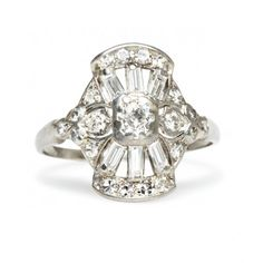 Wetherby is a dramatic vintage Art Deco engagement ring studded with baguette and single cut diamonds in an unusual platinum setting. Gorgeous! TrumpetandHorn.com   $2,550