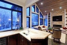 Love, LOVE all of the windows!!! I would love to be able to incorporate something like this in our cabin!