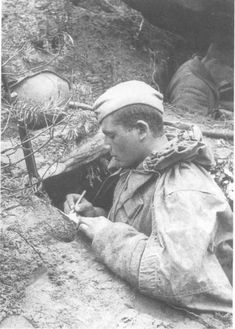Soviet soldiers in the trenches writing a letter. Western Front, 1941