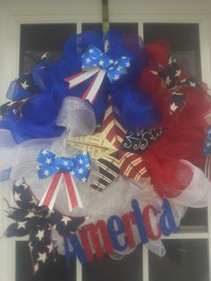 My handmade with love 4th of July Wreath.Made of deco mesh red,white and blue with a metal AMERICA sign,and metal star sign and some bow.