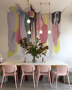 Love love LOVE this colour splash paint wall!!!!!!! And with the lights above the table!