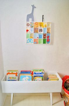 book storage but easier for kids to see titles and choose themselves (vs traditional shelving with spines facing out)