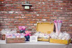 Take-home/Favor Table - I dig the vintage luggage as a container for favors